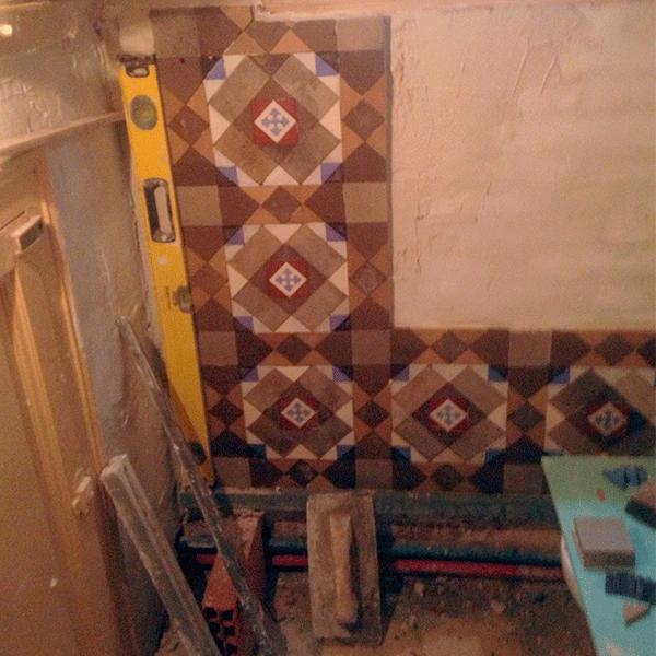 restauracion-de-mosaico-nolla-en-pared